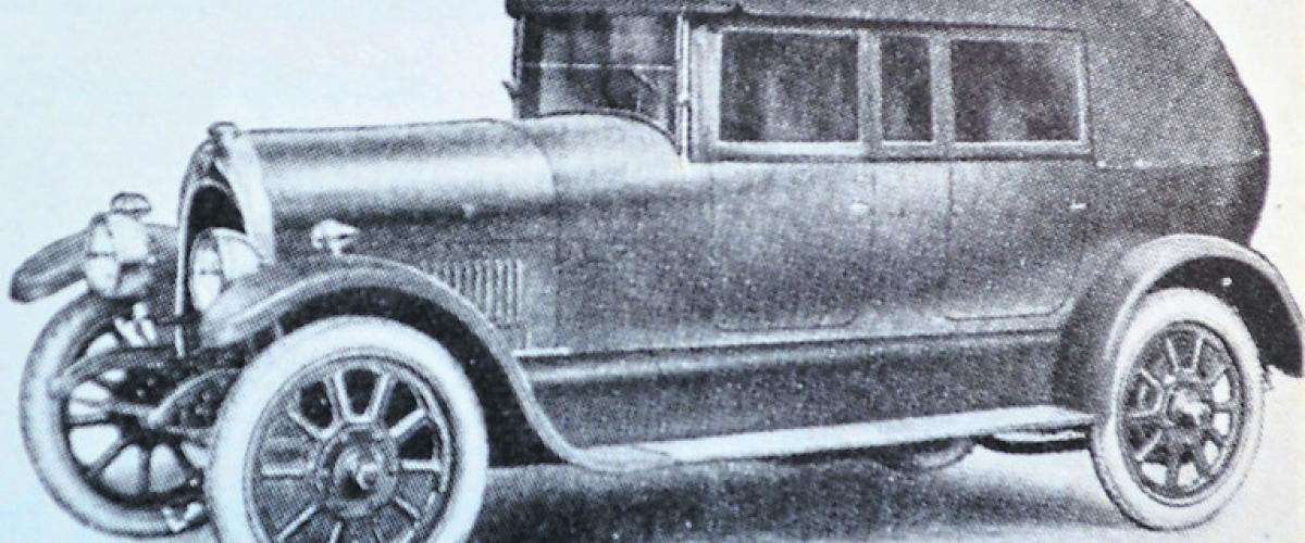 The 1923 Ruston-Hornby A3 model all weather tourer fitted with rigid side curtains.